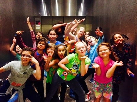 image of kids posing in an elevator